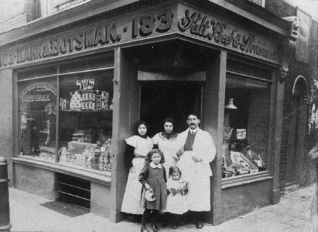 Kahn and Botsman's Salt Beef and Provisions store at 183 Brick Lane. Isaac Botsman and Kever Kahn migrated together from Poland, starting their shop with shared savings of £25. They were open from 6am to midnight. The picture shows Kever Kahn and wife Rose and their two childrenMoving Here catalogue reference (JML) 61.12
